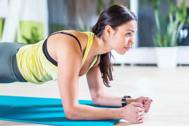 portrait fitness training athletic sporty woman doing plank exercise in