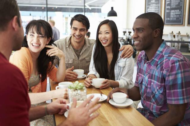 Group Of Friends Meeting In Coffee Shop