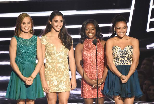 NEW YORK, NY - AUGUST 28:  Madison Kocian, Aly Raisman, Simone Biles and Laurie Hernandez present Best Female Video onstage duri