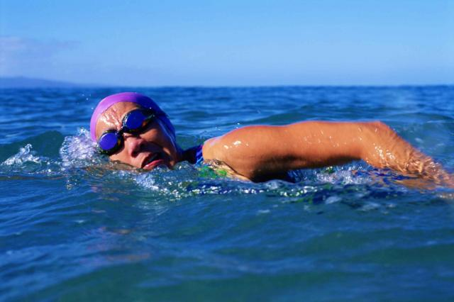 Woman swimming in ocean or lake