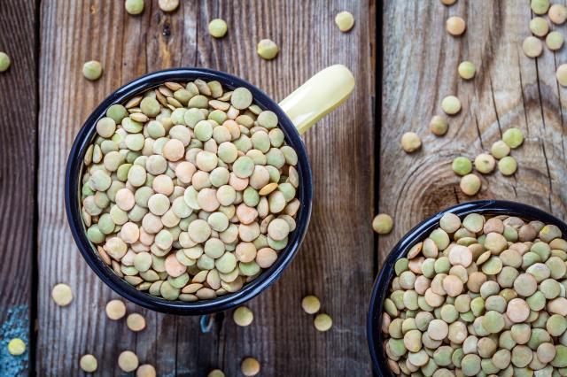 Mug with organic green lentils top view