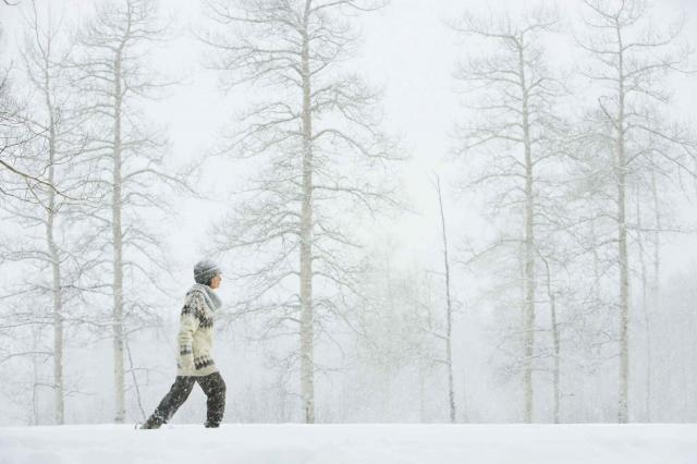 Mature woman walking in snow