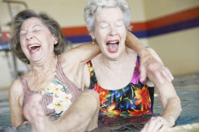 Women Laughing in Swimming Pool