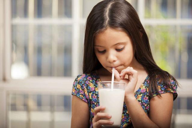 Drinking milk with a straw