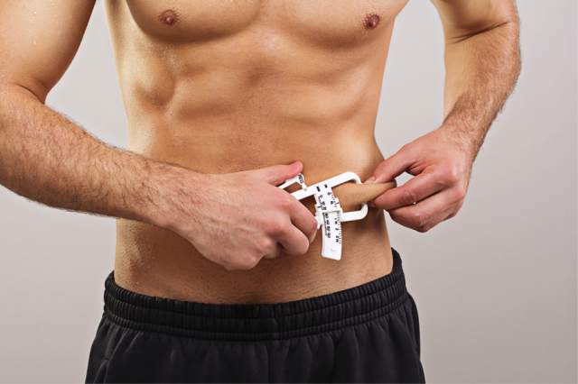 fit man measures body fat