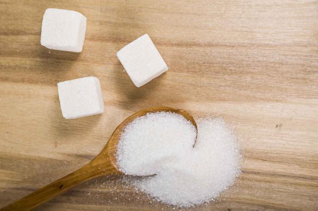 Sugar in a wooden spoon