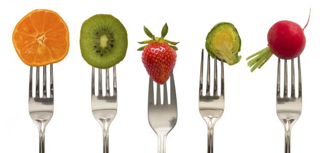 vegetables and fruits on the forks