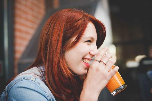 Half length of young handsome caucasian reddish hair woman drink